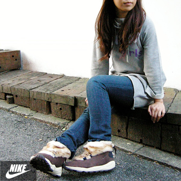 girl wears nike air baked